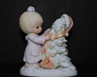 """Precious Moments """"Have A Cozy Country Christmas"""" - Girl Dressing Evergreen Tree For Warm Winter With Scarf And Santa Hat"""