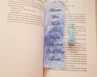Winter was made for warm blankets and big books. Bookmark with tassel. Laminated bookmark