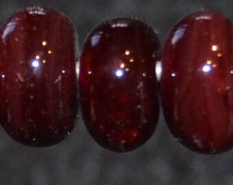 Carmine- seven boro lampwork beads. SRA K45
