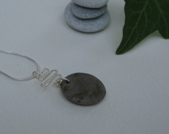 Mediterranean stone pedant with sterling silver finishes on a sterling silver snake chain.