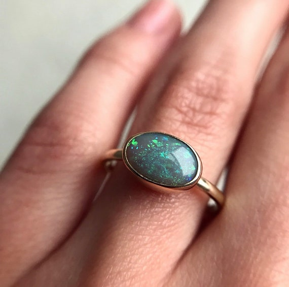 14K yellow gold ring with  black opal SZ 7