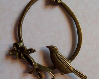 Bird and flower bronze charm