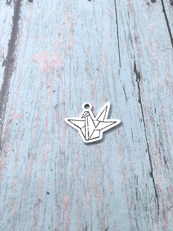 8 origami crane charms 1 sided silver crane pendants origami 8 origami crane charms 1 sided silver crane pendants origami crane pendants bird charms asian bird pendant japanese charm from kimsfancyfindings on aloadofball Images