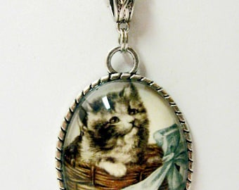 Gray cat in a basket pendant with chain - CAP09-006