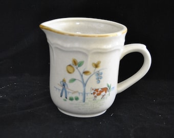 Creamer with the Heartlnd Pattern from International Stoneware