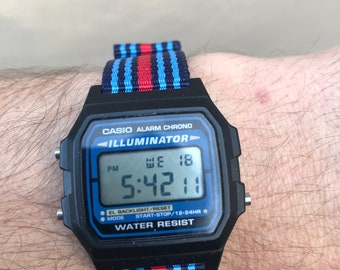 Black Illuminator Casio on Blue and Red Striped NATO Strap, minimalistic watch, bright illumination