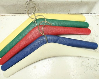 Five vintage multi coloured coat hangers
