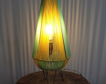 Very rare 1950s light in metal and yellow/turquoise vinyl wire (Danish? Swedish? French? Eastern Europe?). Working and in good shape.