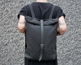 Black rolltop backpack/ rucksack for cycling and travel