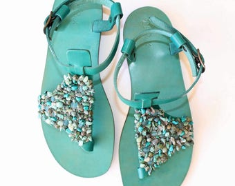 Flip-flops sandals in leather with jewelery