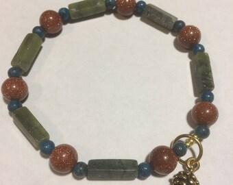 Beautiful Jade, Golden Sandstone, And Picasso Jasper Bracelet Gold Pine Cone Charm