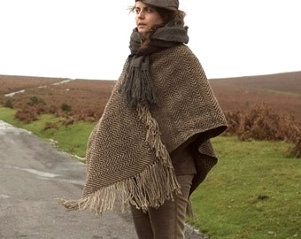 Women's or men's poncho or cape handwoven in rugged brown waxy wool in a Jacquard pattern