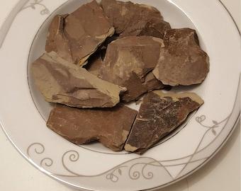 Edible natural grey roasted clay.