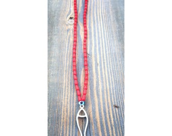 Handmade red coral necklace with silver fish
