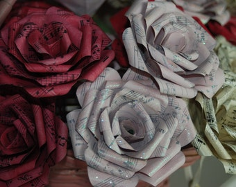 Pink and red hand painted paper flowers made from vintage sheet music