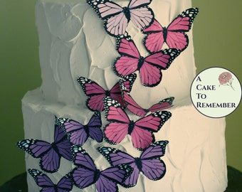 Girl's 1st birthday photo shoot prop, two tier fake cake with pink and purple butterflies. Faux cake for fairy party decorations