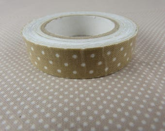 Roll of masking tape beige dots