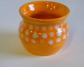 Orange wheel thrown pot with white Dot Pattern