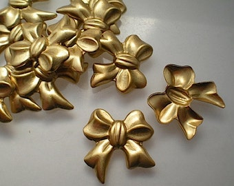 12 brass bow charms