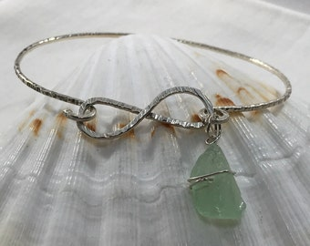 Sea glass jewelry,  hammered sterling silver infinity bracelet with a seafoam seaglass charm
