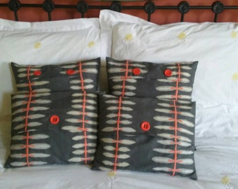 Grey and coral pink embroidered linen cushion