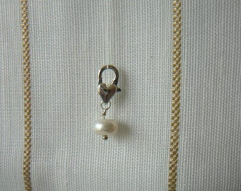 Pearl White, mounted on silver metal clasp charm
