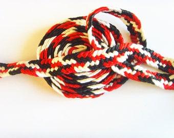 Ribbon braid white red black jewelry fashion accessory.