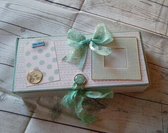 Mini baby boy in a wooden box gr: 23 x 10 cm