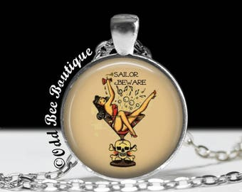 """Sailor Jerry Tattoo Flash Art Sailors Beware Pinup Girl Necklace. Old School Traditional Retro Rockabilly Jewelry. 1"""" Silver & Glass Pendant"""