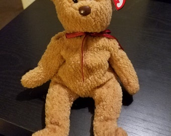 Rare and Retired TY Brand Curly the bear Beanie Baby with some tag errors