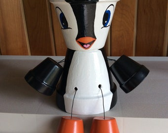 Hand painted penguin terra cotta plant pot statue. Indoors / outdoors. Made to order.