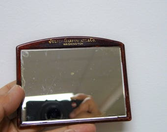 Colbert for Julius Garfinckel & Co.    60s 70s carry on small plastic pocket mirror
