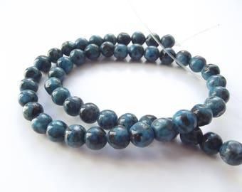 46 round irregular tinted REIA 804 8 mm larvikite beads