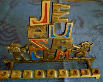 Vintage Judaica brass Chanukah Menorah with Jerusalem carved letter and two lions, red and blue enamels