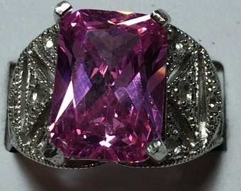 Pink sapphire and silver ring