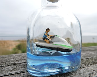 Ship in a bottle, Jet Ski, cruising on blue water
