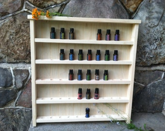 Unfinished pine, hand-crafted, essential oil shelf. Holds up to 50 bottles.