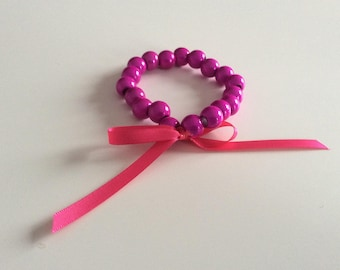Fuchsia with a satin bow bracelet.