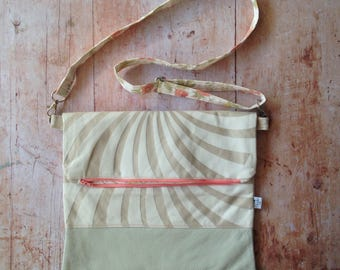 Foldover clutch with cream beige stripes and cream leather base