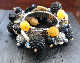 Peach Cosmo - cha cha style stretch bracelet with new and repurposed beads and buttons on a silver plated stainless steel stretch base