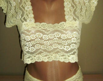 set in pale yellow lace undergarment