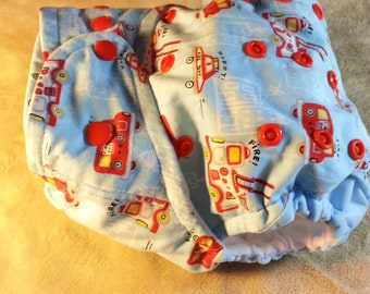 SassyCloth one size pocket diaper with little firetrucks cotton print. Made to order.