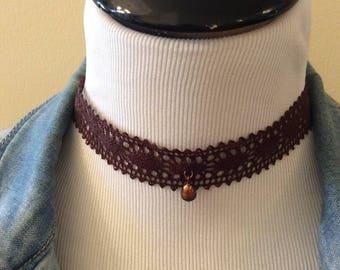 Crochet choker with fresh water pearl.