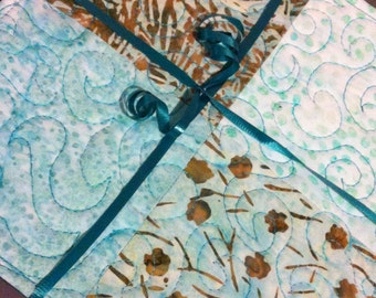 Beautiful pot holders in blues, aquas, teals & tan batiks
