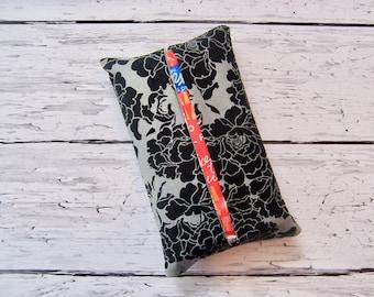 Kleenex travel tissue case in a black and gray fabric , very classic  , pocket tissue , travel tissue, kleenex case