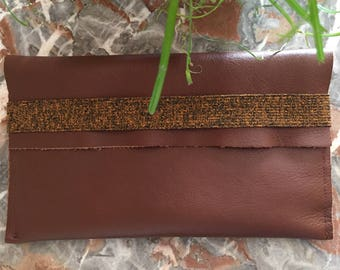 Dark brown leather checkbook wallet.