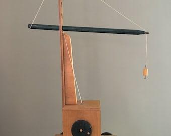 Handmade vintage crane made of wood