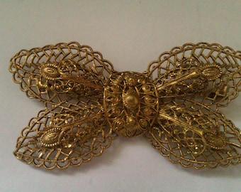 vintage filigree butterfly shaped brooch