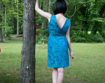 1950s . brilliant blue and green floral wiggle dress . small