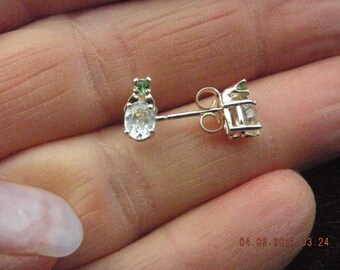 White sapphire earrings with Tsavorite accents